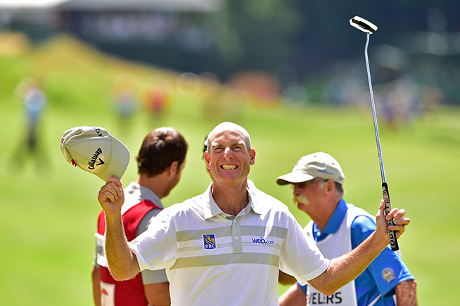 CROMWELL, CT - AUGUST 07:  Jim Furyk of the United States celebrates after shooting a record setting 58 during the final round of the Travelers Championship at TCP River Highlands on August 7, 2016 in Cromwell, Connecticut.  (Photo by Steven Ryan/Getty Images)