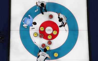 Curling - Pyeongchang 2018 Winter Olympics - Men's Round Robin - U.S. v Japan - Gangneung Curling Center - Gangneung, South Korea - February 18, 2018 - Tyler George of the U.S., and Tetsuro Shimizu, Tsuyoshi Yamaguchi and Kosuke Morozumi of Japan. REUTERS/Cathal McNaughton